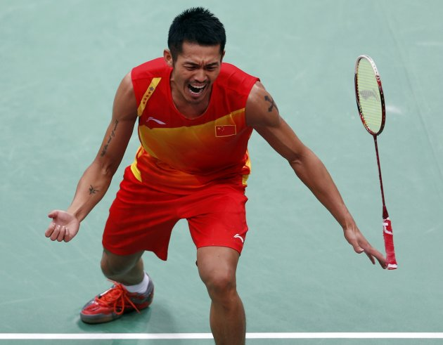 China's Lin Dan celebrates after winning the gold medal in men's singles badminton. (Reuters)