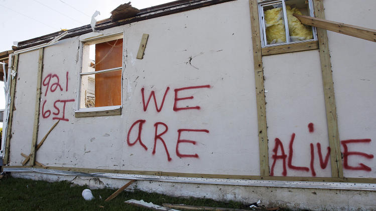 A message is seen on the side of a house, Thursday, May 5, 2011, that was destroyed when a tornado ripped through the area the week before in Pleasant Grove, Ala. (AP Photo/Butch Dill)