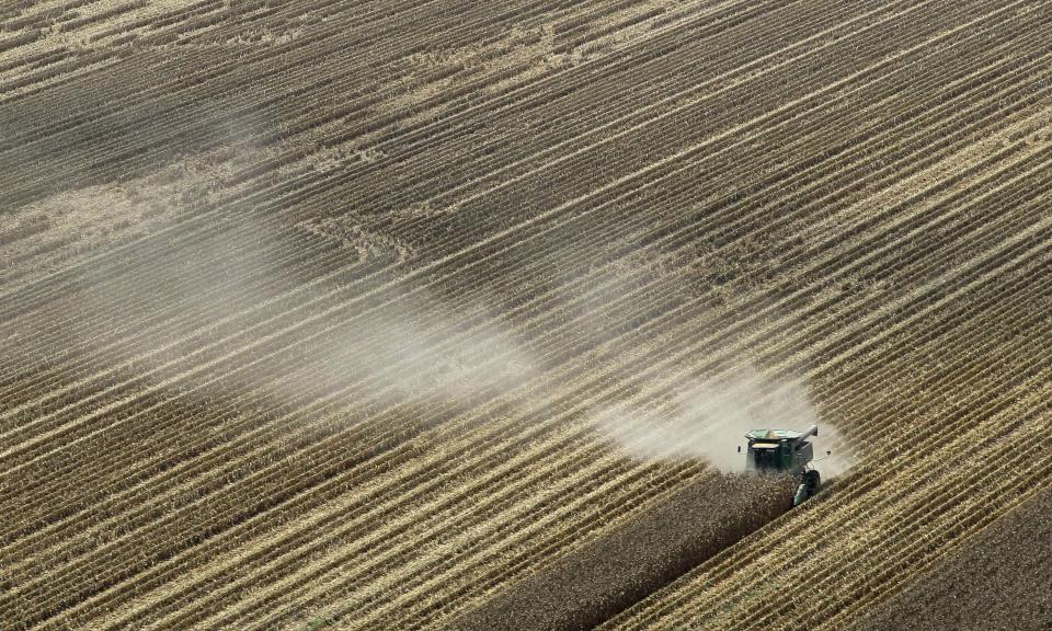 Dust is blown from behind a combine harvesting corn in a field near Coy, Ark., Thursday, Aug. 16, 2012. Federal weather forecasters say drought conditions appear to be leveling off, although it is likely to continue at least through November. (AP Photo/Danny Johnston)