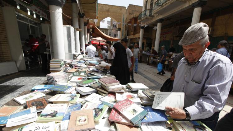 Residents shop for books at Mutanabi Street in Baghdad
