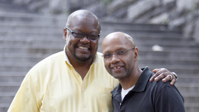 In this July 19, 2011 photo, Stephen Williams, right, and partner Joey Pressley pose for a portrait in New York. Williams, 49, and Pressley, 48, are planning to get their marriage license on Sunday, July 24, and get hitched at a ceremony on Friday at a restaurant in Harlem. Former Mayor David Dinkins, whom Pressley met while attending a class at Columbia University, will officiate. (AP Photo/Mary Altaffer)