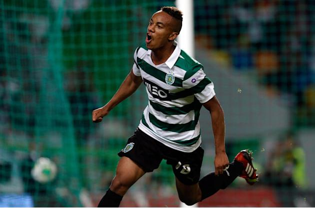Sporting's Andre Carrillo, from Peru, celebrates after scoring their second goal against Setubal  during their Portuguese league soccer match Saturday, Oct. 5 2013, at Sporting's Alvalade stadium in L