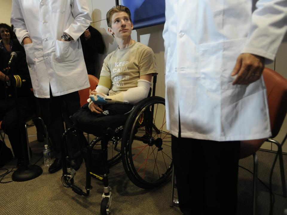 Retired Infantryman Brendan M. Marrocco listens during a news conference Tuesday, Jan. 29. 2013 at Johns Hopkins hospital in Baltimore.  Marrocco received a transplant of two arms from a deceased donor after losing all four limbs in a 2009 roadside bomb attack in Iraq. (AP Photo/Gail Burton)