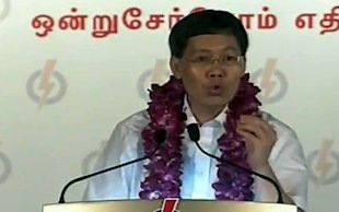"Lui Tuck Yew tells voters about a ""trees and mushrooms"" story. (Yahoo! photo/YouTube)"