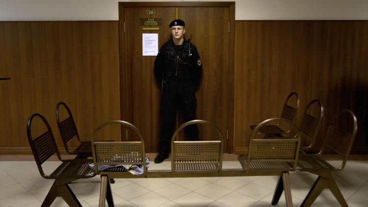 "A policeman guards a court room in Moscow, Russia, on Monday Oct. 1, 2012.  The Russian court is set to hear an appeal filed by three jailed members of the rock band Pussy Riot, but postponed the appeal until Oct. 10 after one of the group fired her lawyers.  The group were sentenced to two years for performing a ""punk prayer"" against President Vladimir Putin inside Moscow's main cathedral. (AP Photo/Ivan Sekretarev)"