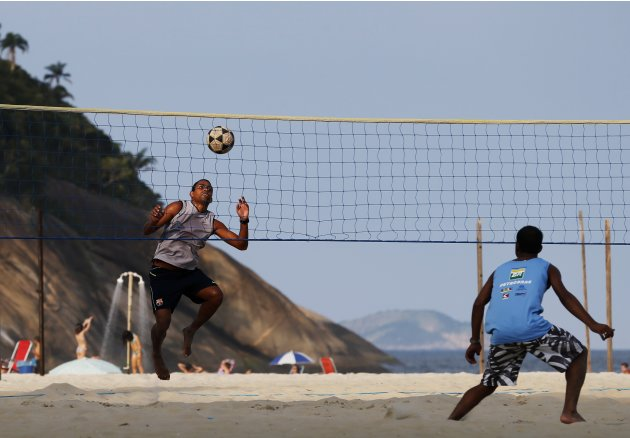 Residents play footvolley at Copacabana beach ahead of the Confederations Cup in Rio de Janeiro