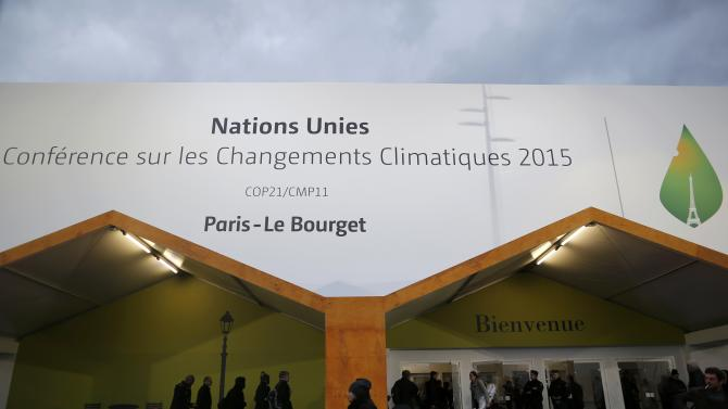 Participants are pictured in front of the entrance at the venue for the World Climate Change Conference 2015 (COP21) at Le Bourget, near Paris, France