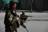 Afghan soldiers patrol the streets of Kabul in April 2012. Afghan intelligence forces say they have foiled a large attack in Kabul, arresting a Pakistani suicide bomber driving a truck packed with 1,000 kilograms of explosives