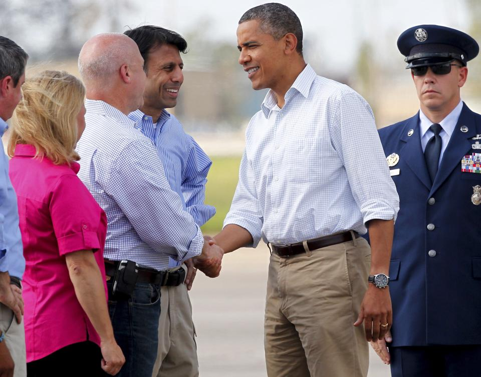 President Barack Obama greets New Orleans Mayor Mitch Landrieu, as Louisiana Gov. Bobby Jindal, center, and Sen. Mary Landrieu, D-La., watch as he arrives at Louis Armstrong New Orleans International Airport in Kenner, La., Monday, Sept. 3, 2012. (AP Photo/Jonathan Bachman)