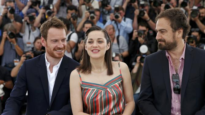 """Cast members Michael Fassbender and Marion Cotillard, and director Justin Kurzel pose during a photocall for the film """"Macbeth"""" in competition at the 68th Cannes Film Festival in Cannes"""