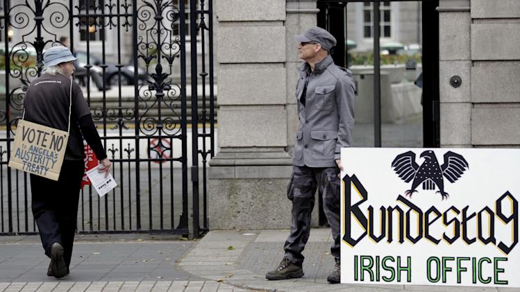 No protesters making their point outside Leinster House, (Irish Parliament) in Dublin, Ireland, Wednesday, May 30, 2012.  Ireland goes to the polls Thursday to vote on the European Fiscal Treaty Referendum.  (AP Photo / Peter Morrison)