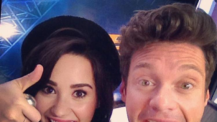 Demi Lovato and Ryan Seacrest