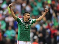 Mexico's Oribe Peralta celebrates after scoring against New Zealand during their 2014 World Cup qualifying playoff first leg soccer match at Azteca stadium in Mexico City November 13, 2013. REUTERS/Henry Romero/Files