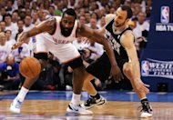 Oklahoma City Thunder's James Harden (L) and San Antonio Spurs' Manu Ginobili durin game six of their NBA Western Conference Finals on June 6. Thunder will meet the winner of the Boston and Miami series for the NBA championship