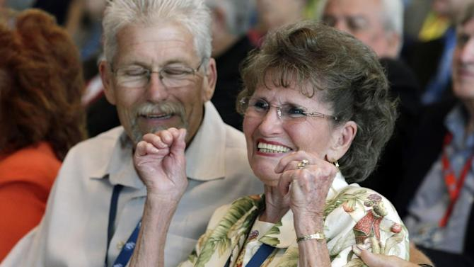 Family of the late Tim Flock, wife Frances and son Carl, cheer after Tim Flock was posthumously named to the next class of inductees during an announcement at the NASCAR Hall of Fame in Charlotte, N.C., Wednesday, May 22, 2013. (AP Photo/Chuck Burton)