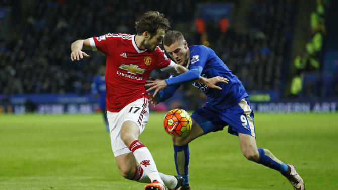 Manchester United's Daley Blind and Leicester City's Jamie Vardy