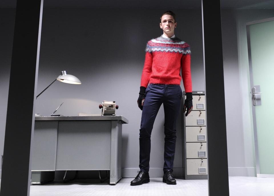 A model wears a creation by French fashion designer Guillaume Henry for Carven's fall-winter 2013/2014 men's fashion collection, presented in Paris, Wednesday, Jan.16, 2013. (AP Photo/Zacharie Scheurer)
