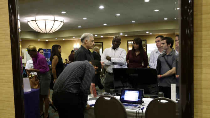 FILE-In this Monday, Sept 17, 2012, file photo, Robert Orkin, of  the company TxT-Alert, third from left, talks with job seekers during a job fair held by National Career Fairs,  in Fort Lauderdale, Fla. Economists forecast that the unemployment rate edged up in September to 8.2 percent from 8.1 percent, according to a survey by FactSet. Employers are expected to have added 111,000 jobs. (AP Photo/Lynne Sladky, File)