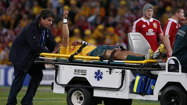 Australia's Christian Lealiifano is stretchered from the field during their rugby union Test match against British and Irisih Lions at Suncorp Stadium in Brisbane