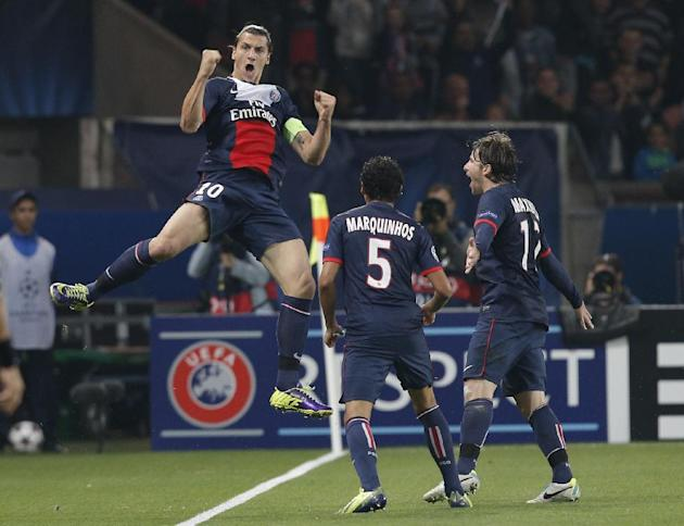 PSG's Zlatan Ibrahimovic, jumps in the air as he celebrates scoring a goal during the Champions League group C soccer match between Paris Saint Germain and Benfica, at the Parc des Princes stadium, in