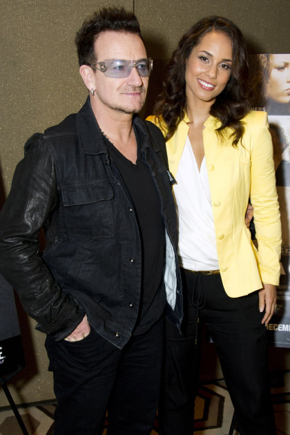 "Bono, left, and Alicia Keys attend the premiere of the Showtime documentary ""Keep a Child Alive with Alicia Keys"", in New York, Tuesday, Nov. 29, 2011. (AP Photo/Charles Sykes)"
