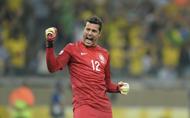 In this June 26, 2013 file photo, Brazil's Julio Cesar celebrates his team's 2-1 victory at a Confederations Cup semifinal soccer match with Uruguay in Belo Horizonte, Brazil. Cesar is the wea