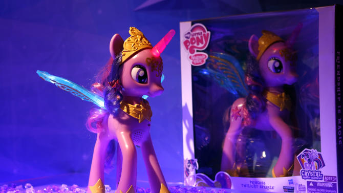 "IMADE DISTRIBUTED FOR HASBRO - The MY LITTLE PONY PRINCESS TWILIGHT SPARKLE figure illuminates in Hasbro's showroom at the American International Toy Fair, Sunday, Feb. 10, 2013, in New York.  The princess pony figure, available at retail Fall 2013, is inspired by the upcoming coronation of TWILIGHT SPARKLE in the animated series ""My Little Pony Friendship is Magic,"" created by Hasbro Studios and airing on the Hub TV Network in the US. (Photo by Jason DeCrow/Invision for Hasbro/AP Images)"