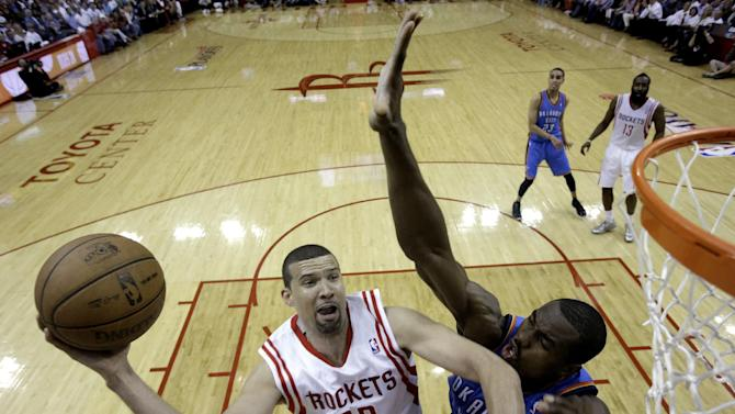 Houston Rockets' Francisco Garcia (32) goes up for a shot as Oklahoma City Thunder's Serge Ibaka (9) defends during the second quarter of Game 3 in a first-round NBA basketball playoff series Saturday, April 27, 2013, in Houston. (AP Photo/David J. Phillip)