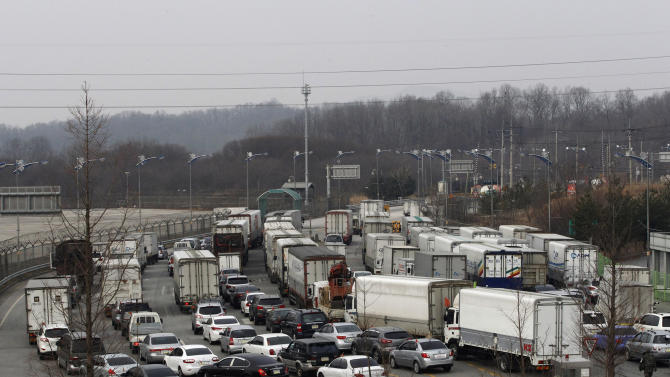 """South Korean vehicles head to the North Korean city of Kaesong at the customs, immigration and quarantine office in Paju, South Korea, near the border village of Panmunjom,  Monday, April 1, 2013. North Korea warned South Korea on Saturday that the Korean Peninsula had entered """"a state of war"""" and threatened to shut down a border factory complex that's the last major symbol of inter-Korean cooperation. (AP Photo/Ahn Young-joon)"""