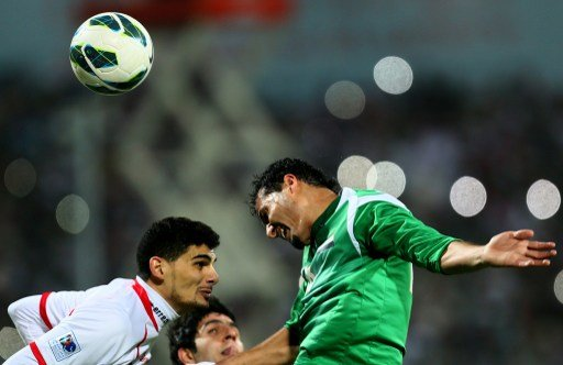 Hussam al-Sarry (R) of Iraq vies with Mohannad Salem of UAE as he attempts to score during the 21st Gulf Cup's final between United Arab Emirates (UAE) and Iraq on January 18, 2013 in Manama. United A