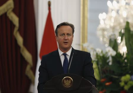 Cameron addresses the media at the Presidential Palace in Jakarta, Indonesia