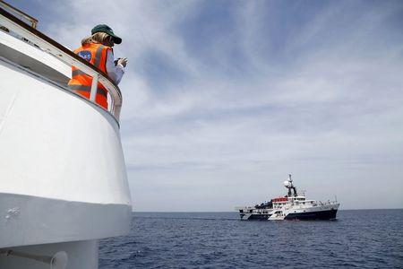Migrant Offshore Aid Station founder Regina Catrambone of Italy watches as the MOAS ship MV Phoenix sails outside Valletta's Grand Harbour