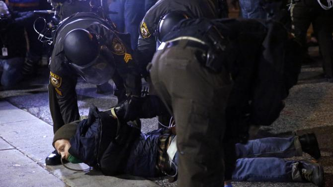 A protester is arrested in front of the Ferguson Police Department, in Ferguson