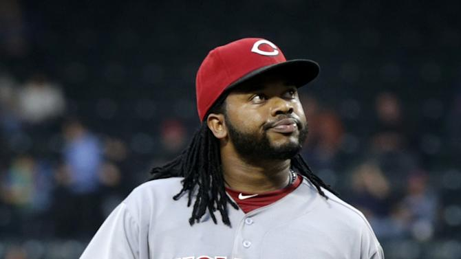 Cincinnati Reds starting pitcher Johnny Cueto reacts at the end of the first inning of the baseball game against the New York Mets at Citi Field Monday, May 20, 2013 in New York. (AP Photo/Seth Wenig)