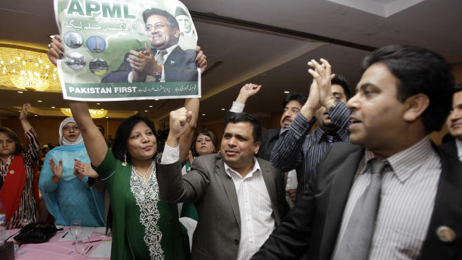 Supporters of Former Pakistani President Pervez Musharraf hold his poster and chant slogans during a ceremony to celebrate Pakistan National Day ahead his trip to Karachi on Sunday, in Dubai, United Arab Emirates, Saturday, March 23, 2013. Musharraf says he will follow through with his plans to return to his homeland despite risks of arrest and other threats. (AP Photo/Kamran Jebreili)