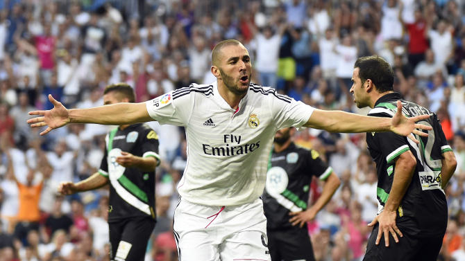 Real Madrid's French forward Karim Benzema celebrates after scoring during the Spanish league football match Real Madrid CF vs Cordoba CF at the Santiago Bernabeu stadium in Madrid on August 25, 2014