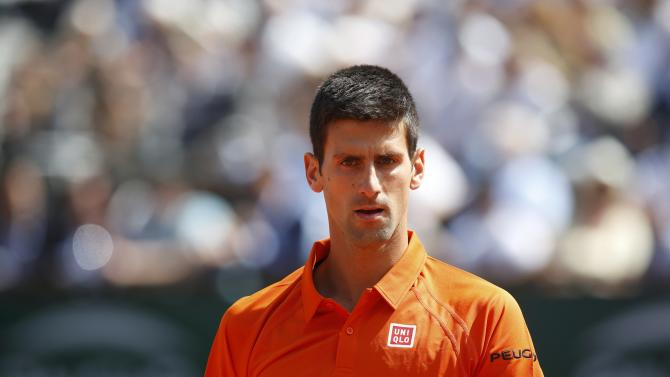 Novak Djokovic of Serbia reacts during his men's quarter-final match against Rafael Nadal of Spain during the French Open tennis tournament at the Roland Garros stadium in Paris