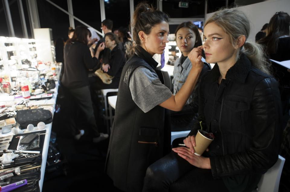 A model is prepared ahead of the Zoe Jordan collection during London Fashion Week, Friday, Feb. 15, 2013, in London. (Photo by Jonathan Short/Invision/AP)