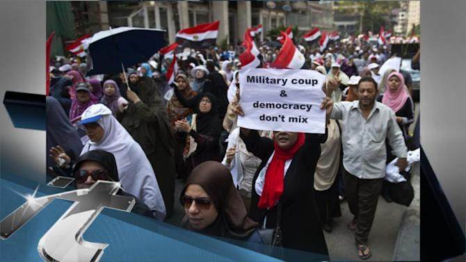 War & Conflict Breaking News: Morsi Supporters March on Army Intelligence Headquarters