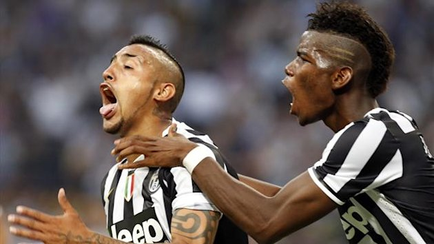 Juventus' Arturo Vidal (L) celebrates with his teammate Paul Pogba after scoring against Inter Milan during their Italian Serie A match at San Siro (Reuters)