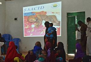 Somali mothers attend a presentation on malnutrition …