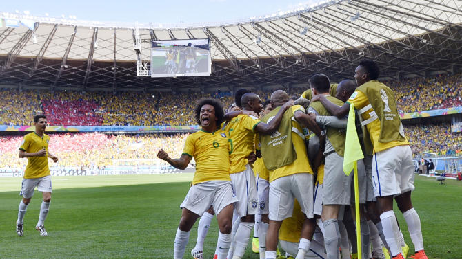 Brazilian players celebrate after Brazil's opening goal during the World Cup round of 16 soccer match between Brazil and Chile at the Mineirao Stadium in Belo Horizonte, Brazil, Saturday, June 28, 2014. (AP Photo/Martin Meissner)