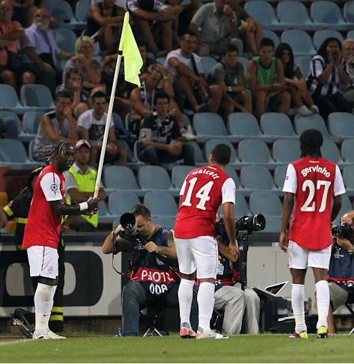 Arsenal's defender Bacary Sagna of Arsenal, left, celebrates with teammates after scoring against Udinese during a Champions League qualifying playoff second leg soccer match in Udine, Italy, Wednesday, Aug. 24, 2011. Arsenal won 2-1 and advances 3-1 on aggregate. (AP Photo/Paolo Giovannini)