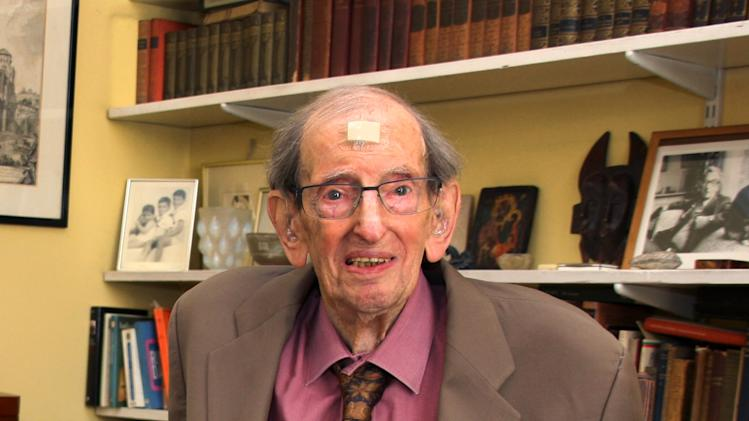 This image made available Monday Oct. 1, 2012 by Birkbeck, University of London shows British historian Eric Hobsbawm in September, 2012 at his house in London.  Eric Hobsbawm, who died early Monday Oct. 1. 2012 aged 95, was honored as one of Britain's most distinguished historians, despite retaining an allegiance to the Communist Party that lasted long after many supporters had left in disgust. He was read by generations of students and revered for his ability to make history come alive, using his socialist perspective to tell stories from the peoples' point of view.  (AP Photo/John Moore, Birkbeck, University of London, HO)