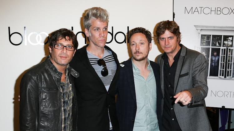 This image released by Starpix shows members of the band Matchbox Twenty, from left, Brian Yale, Kyle Cook, Paul Doucette and Rob Thomas, pose during a Fashion's Night Out event at Bloomingdale's, Thursday, Sept. 6, 2012 kicking off Fashion Week in New York. (AP Photo/Starpix, Andrew Toth)