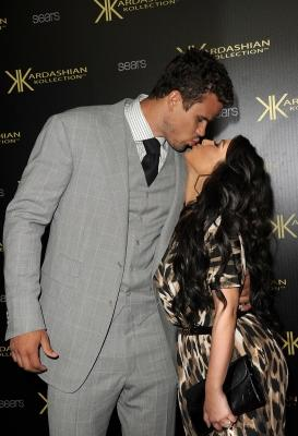Kris Humphries and Kim Kardashian share a kiss on the red carpet of the Kardashian Kollection Launch Party in Hollywood, Calif.on August 17, 2011 -- Getty Images