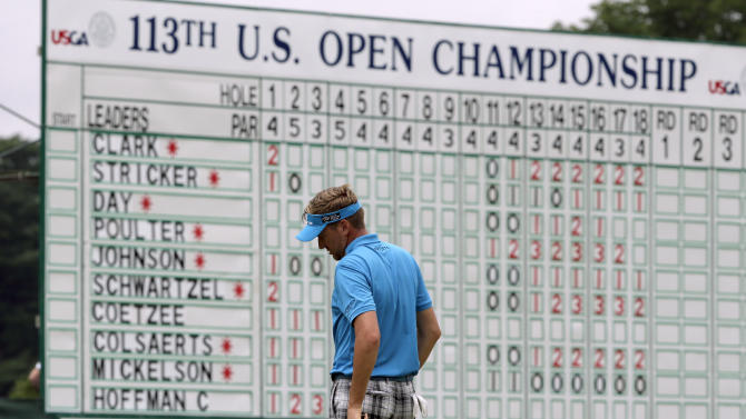 Ian Poulter, of England, reacts after missing a putt on the 18th hole during the first round of the U.S. Open golf tournament at Merion Golf Club, Thursday, June 13, 2013, in Ardmore, Pa. (AP Photo/Charlie Riedel)
