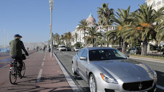 "The new Maserati Quattroporte is displayed on ""la Promenade des Anglais"" in Nice, southern France, during a presentation to the media, Monday, Dec. 10, 2012. The new sixth-generation Maserati Quattroporte is a luxury four-door saloon made by Maserati in Italy and will be shown at the Detroit motor show in January 2013, production started in November 2012. (AP Photo/Lionel Cironneau)"
