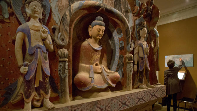"""The central pillar of Mogao Cave 432, from the Western Wei Dynasty, 535-556 AD, is presented in """"Dunhuang: Buddhist Art at the Gateway of the Silk Road,"""" at the China Institute, in New York,  Tuesday, April 24, 2013. (AP Photo/Richard Drew)"""