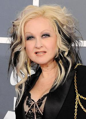"""FILE - In this Feb. 12, 2012 file photo, Cyndi Lauper arrives at the 54th annual Grammy Awards in Los Angeles. A new musical bringing together Tony Award-winner Harvey Fierstein and rock icon Cyndi Lauper is to high-step it to Chicago this fall. Producers said Wednesday that """"Kinky Boots"""" will make its world premiere at the Bank of America Theatre in October ahead of a possible Broadway transfer. Casting and specific dates haven't been announced. (AP Photo/Chris Pizzello, file)"""